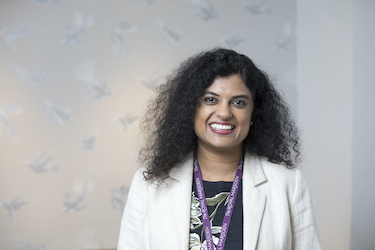Susana Banerjee Consultant Medical Oncologist headshot wearing white jacket in Granard House Private Care reception area